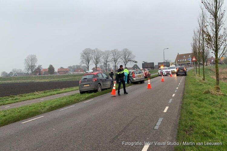 Auto tegen lantaarnpaal aan Rustenburgerweg